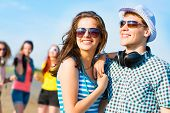 picture of crazy hat  - young couple standing on the road - JPG