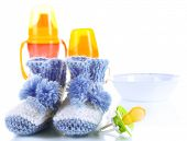 Composition with crocheted booties for baby, isolated on white