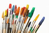 stock photo of bristle brush  - Brushes and paints to paint laid on the table in the composition - JPG