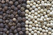 pic of peppercorns  - black and white peppercorns mix as a background - JPG