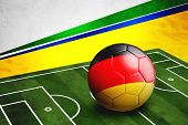 stock photo of football pitch  - Soccer ball with Germany flag on soccer pitch - JPG