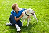 stock photo of mans-best-friend  - smiling man with his Labrador in garden - JPG