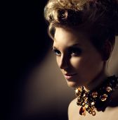 Glamour lady portrait. Beautiful model girl with perfect fashion makeup and hairstyle. Trendy access