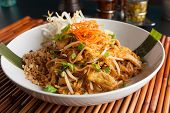 stock photo of fried chicken  - Chicken pad Thai dish of stir fried rice noodles with a contemporary presentation - JPG