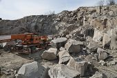 stock photo of earth-mover  - Granite quarry Working mining machines - JPG