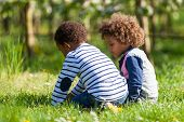 stock photo of black american  - Cute african american little boys playing outdoor  - JPG