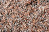 picture of feldspar  - rough pink and gray feldspar granite rock surface - JPG