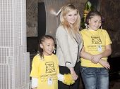 NEW YORK-APR 21, 2014: Unidentified children from Project Sunshine meet Actress Abigail Breslin at t