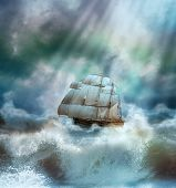 stock photo of galleon  - old ship sailing  in a sea thunderstorm with big waves - JPG