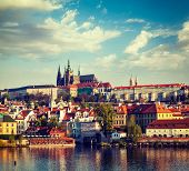 Vintage retro hipster style travel image of Mala Strana and  Prague castle over Vltava river. Prague