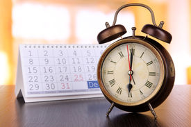 picture of countdown timer  - Alarm clock  and calendar on bright background - JPG