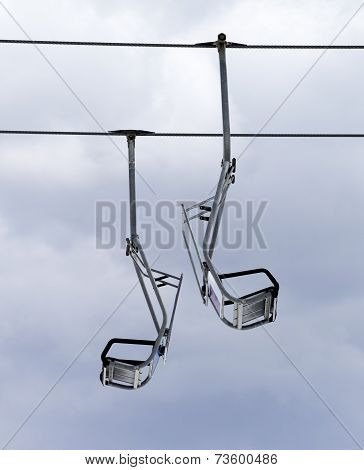 Chair-lifts And Overcast Sky
