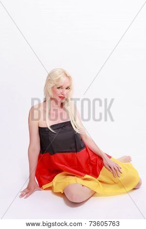 Young woman wrapped naked with Germany flag