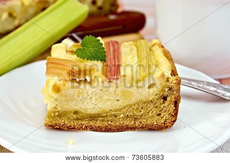 Pie with curd and rhubarb on plate