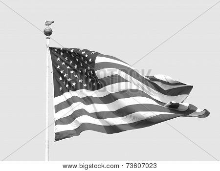 The American Flag Flies On A Sunny Day Against A Clear Sky