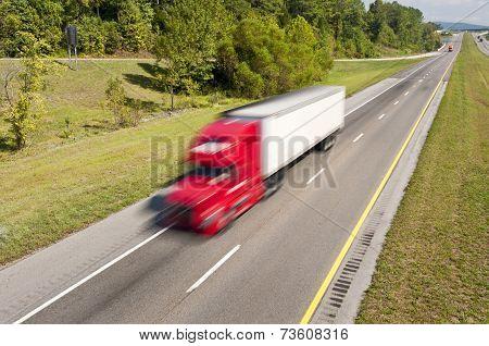 Truck Speeding Down Highway
