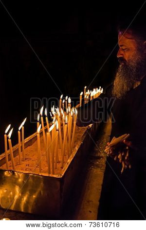 Monk Cleans Candles