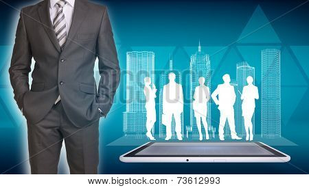 Businessman with wire-frame buildings, tablet and business silhouettes