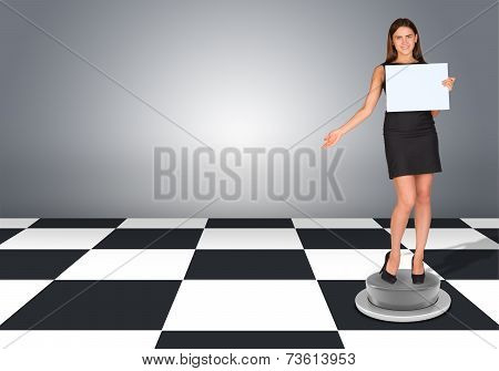 Beautiful businesswomen in dress holding empty paper