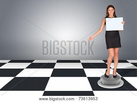 Beautiful businesswomen in dress holding empty paper