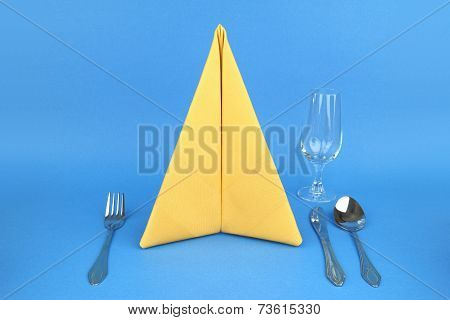 Folded napkin on the blue background