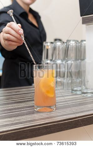 Bartender prevents a cocktail on the bar