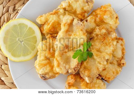 a plate with spanish rape rebozado, battered and fried angler