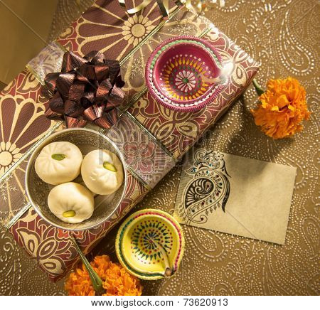 An empty golden tag with diwali gift box.