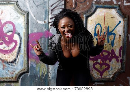 Laughing Woman Giving A Horns Gesture