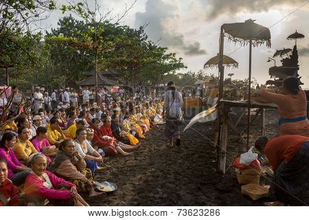 BALI, INDONESIA - SEPTEMBER 19, 2014: Families gather at the beach for the Nyaben 12th day ceremony, to throw the cremated ashes of the dead to sea, a sign of releasing the soul for reincarnation.