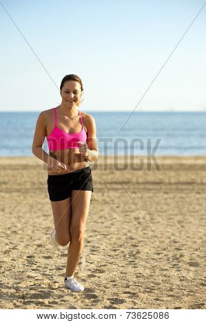 Young, fit, woman during a calisthetics and endurance training on a beach
