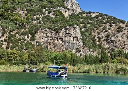 Boats by the rock tombs in Dalya.