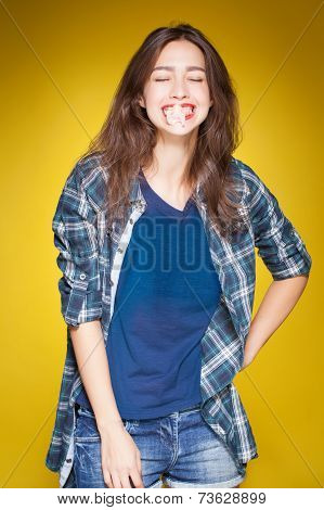 young beautiful girl posing grimacing with chewing gum