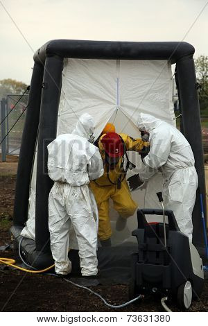 The person in chemical protection suit
