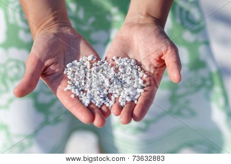 Woman Hands Holding Natural White Marble Stones