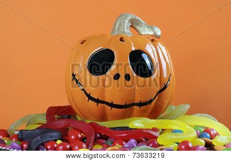Happy Halloween Jack-o-lantern Pumpkin With Colorful Trick Or Treat Candy Jellies, Orange Chocolates
