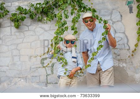 Happy father and son having fun outdoors in city