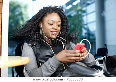 Black Female Listening Music From Phone Play List