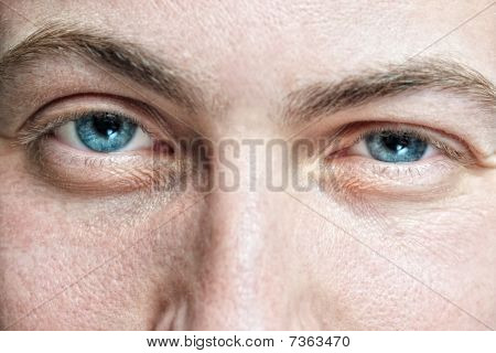 Face With Old Skin And Blue Eyes