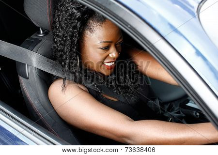Young Black Woman Driving In Safety Seat Belt