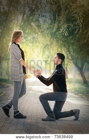 Kneeling Man Proposing with an Engagement Ring