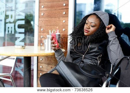 Black Woman In Black Casual Outfit At Coffee Shop
