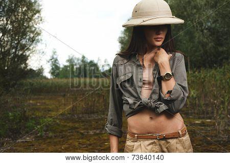 safari woman in  the morning swamp