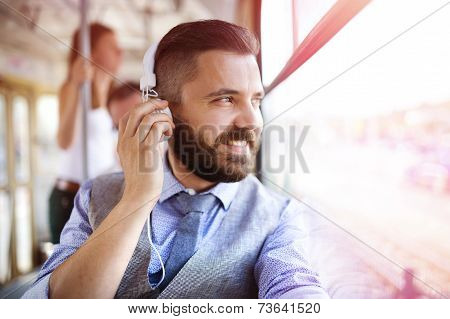 Hipster business man on tram