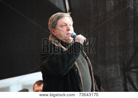 Politician Grigory Yavlinsky on the stage of opposition rally
