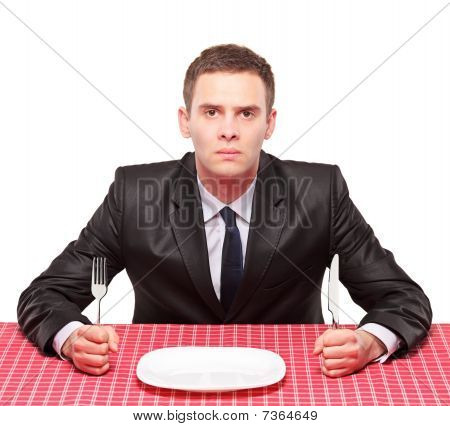 A businessman waiting his meal