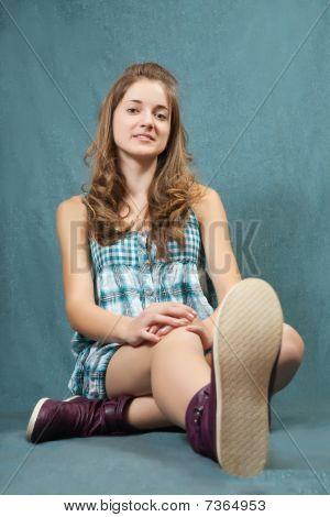 Teenager Girl  Sitting On Grey