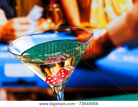 Cocktail Glass In Front Of Gambling Table