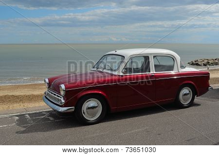 A Classic Hillman Motor Car in Rally on Felixstowe Seafront.