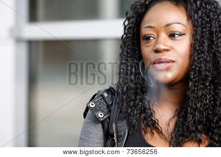 Young African Woman Smoking A Cigarette
